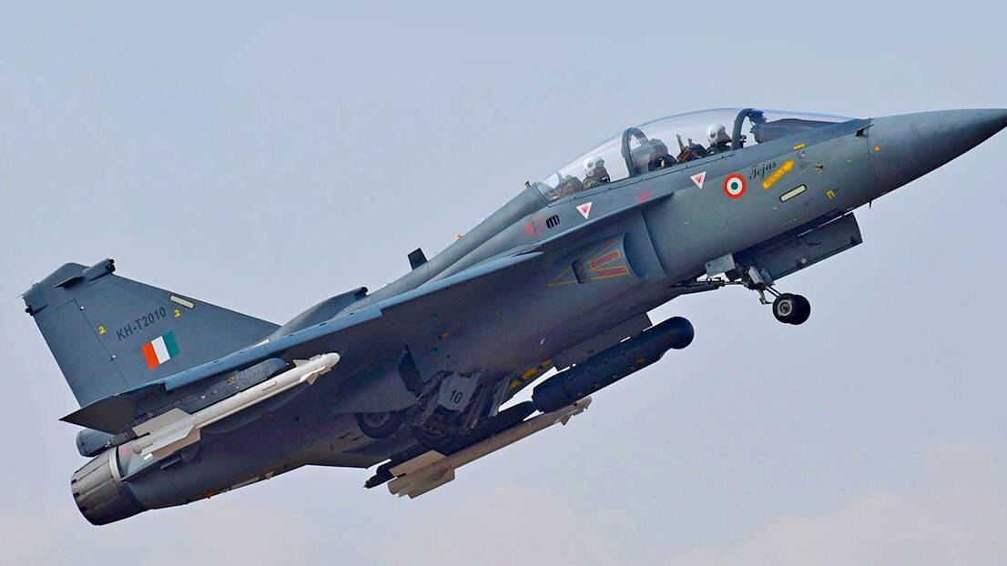 Tejas two seater trainer equipped with R-73 missile and optical targeting pod